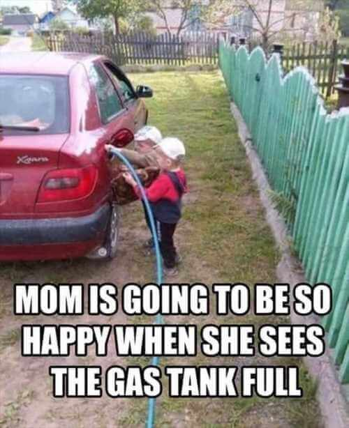 kids filling up the gas tank on the car