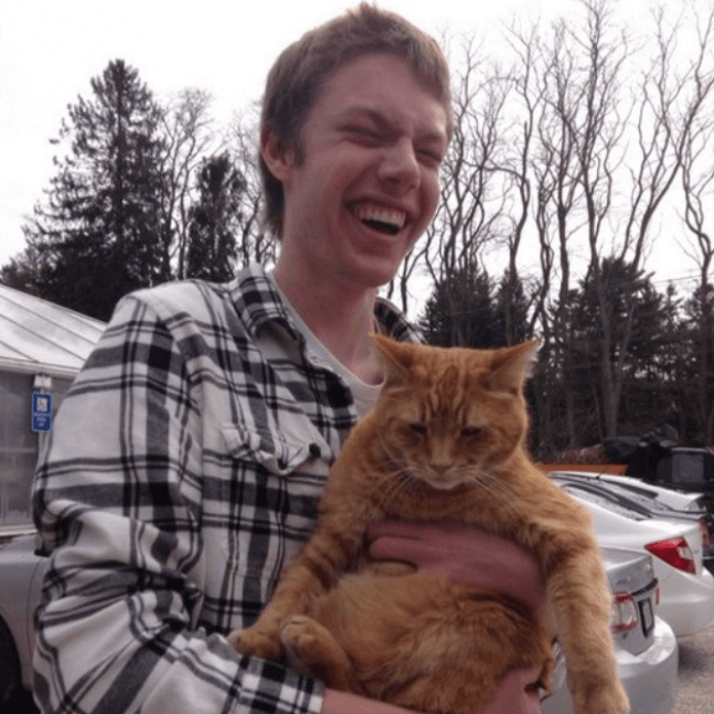 blind guy holds a cat